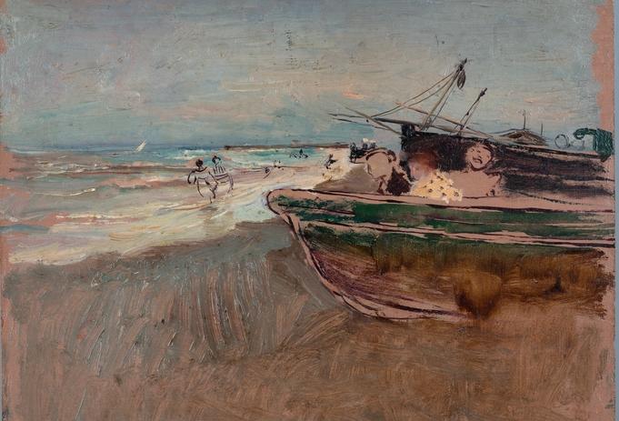 Playa con barcos y bañistas